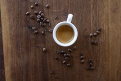 Morning Espresso. Freshly brewed espresso surrounded by coffee beans Stock Images
