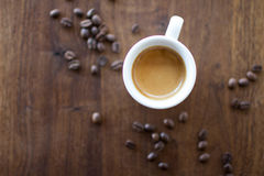 Morning Espresso. Freshly brewed espresso surrounded by coffee beans Royalty Free Stock Image