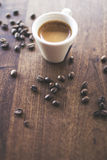 Morning Espresso. Freshly brewed espresso surrounded by coffee beans Stock Photo