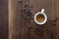 Morning Espresso. Freshly brewed espresso surrounded by coffee beans Stock Photos