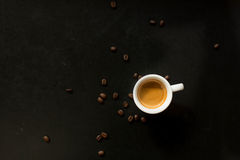 Morning Espresso. Espresso surrounded by coffee beans Stock Photos