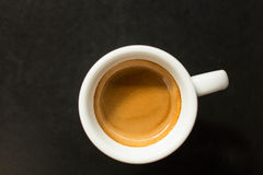 Morning Espresso. Espresso surrounded by coffee beans Stock Photography