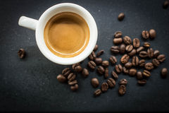 Morning Espresso. Espresso surrounded by coffee beans Royalty Free Stock Photos