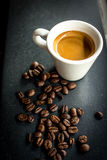 Morning Espresso. Espresso surrounded by coffee beans Royalty Free Stock Images