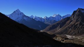 Morning in the Everest National Park, mount Ama Dablam. Landscape on the way to the Everest base camp. Mount Ama Dablam. Hotels in Dughla royalty free stock images
