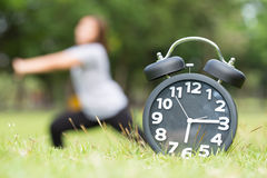 Morning  exercise and black clock Royalty Free Stock Photos