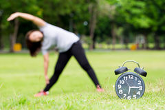 Morning  exercise and black clock. In the park Royalty Free Stock Photography