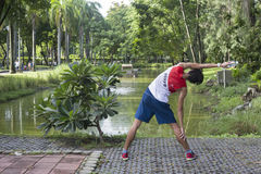 Morning exercises in Lumphini Park, Bangkok, Thailand Stock Photo