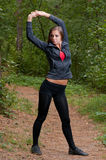Morning exercises in park Royalty Free Stock Images