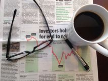 Morning financial paper. Preparing for the days financial markets Royalty Free Stock Image