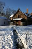 The morning after the first snow. Someone has shoveled a path to the farmhouse in the early morning Stock Images