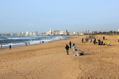Morning Fishermen on Beach with Durban Skyline in Background Stock Image