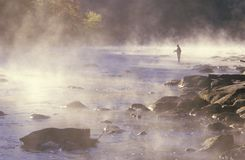 Morning fishing in fog on Housatonic River, Northwestern CT Stock Photo
