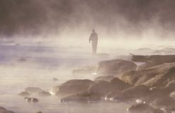 Morning fishing in fog on Housatonic River, Northwestern CT Royalty Free Stock Image
