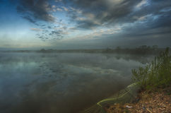 Mystical morning lake fishing Stock Images
