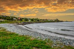 Morning at a fishing village on the Avalon coast, Newfoundland, Canada. Beautiful scenery from Newfoundland landscape, Canada. Rugged ocean scenery and a stock photo