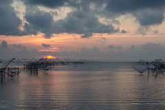 Morning fishnet. Fisher view to commercial  use big fishnet in lake Stock Photos