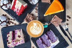 Top view on colorful cake with coffe on white table. Different dessrts. royalty free stock image
