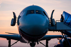 Morning flight. Beautiful sunrise in the summer the airport stock photo