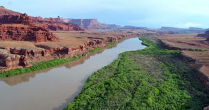 Morning flight over the canyon of Colorado River stock video