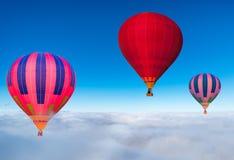 Morning flight of the three hot air balloons. Stock Photo