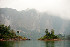 Morning at Floating house in Cheow Larn Lake (Ratchaprapa Dam). Royalty Free Stock Photos