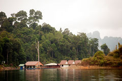 Morning at Floating house in Cheow Larn Lake (Ratchaprapa Dam). Royalty Free Stock Images
