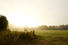 Morning fog. A Foggy morning with farm hay wagon Royalty Free Stock Images