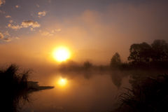 Morning fog. At sunrise over the river Royalty Free Stock Images