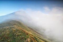 Morning fog around mountaintop Stock Image