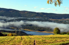 Morning fog in autumn landscape norway Royalty Free Stock Photo