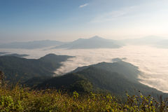 Morning and fog cover mountain at Doi Pha Tang. Sunrise in the morning and fog cover mountain at Doi Pha Tang viewpoint at Chiang Rai province , Thailand Stock Photo