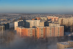 Morning fog covers the city. Stock Photo