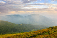 Morning fog covers the mountains top Royalty Free Stock Photo
