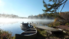 Foggy morning on calm lake Stock Photo