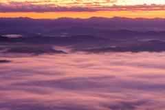 Morning fog on high hill landscape along the valley. Royalty Free Stock Photo