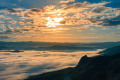 Morning fog on high hill landscape along the valley. Royalty Free Stock Image