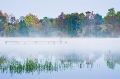 Morning fog on lake Royalty Free Stock Photos