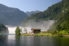 Morning fog lake Königssee in the german Alps Royalty Free Stock Photography