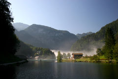 Morning fog lake Königssee in the german Alps Royalty Free Stock Photos