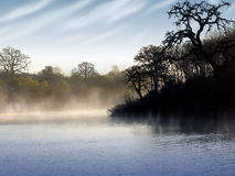 Morning fog on lake Stock Photo