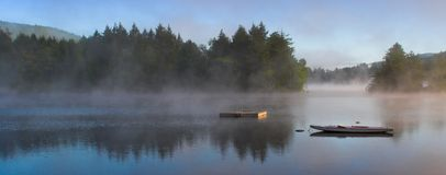 Morning Fog on a Lake (Panorama). A lake in the early morning with rising fog. Panorama format Stock Images