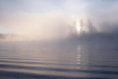 Morning fog lake sun Stock Photos