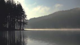 Morning fog on the lake, sunrise shot stock video