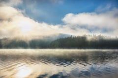 Morning fog on the lake Stock Photo