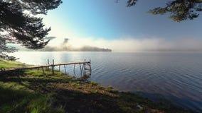 Morning fog on the lake, sunrise shot. stock video footage