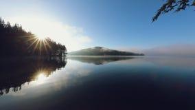 Morning fog on the lake, sunrise shot. stock footage