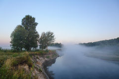 Morning fog like a bridge. Morning fog like a misty bridge Royalty Free Stock Images