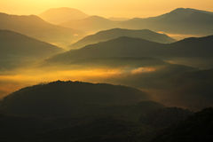 Morning fog in low mountains of the North-Western Caucasus. There is low mountains of the North-Western Caucasus in the morning. Fog and sunlight. Krasnodar Royalty Free Stock Image