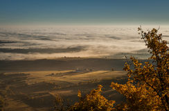 Morning fog. Morning misty hills and mountains with snow royalty free stock photography